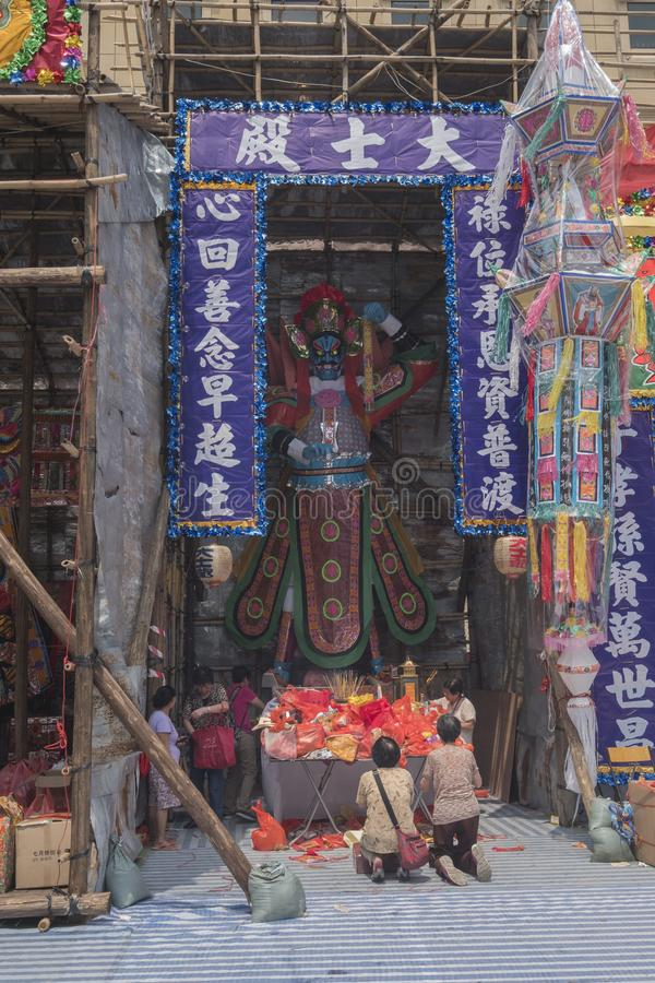 People pray for the Ghost King Da-shi in Chinese Hungry Ghost Yu Lan festival. Taken on 12 September 2017, Hong Kong. People pray for the Ghost King Da-shi in stock photo