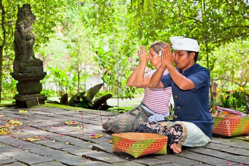 People praying at holy temple Gunung Kawi royalty free stock images