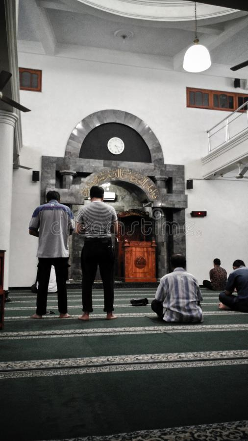 Praying in the mosque royalty free stock images