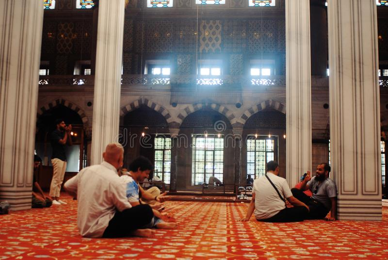 People praying in a Mosque. Religion, god, allaj, allah, religious, prayer, mat, quran, holy stock images