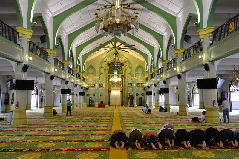Praying at the Sultan Mosque, in Singapore. People praying at the Sultan Mosque, in Singapore stock images