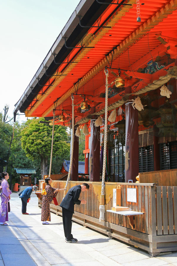 People praying at Yasaka Shrine, a Shinto shrine in the Gion Dis royalty free stock photos
