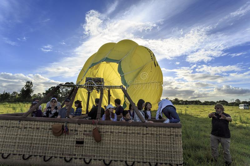 People preparing to disembark after a balloon soft landing royalty free stock image