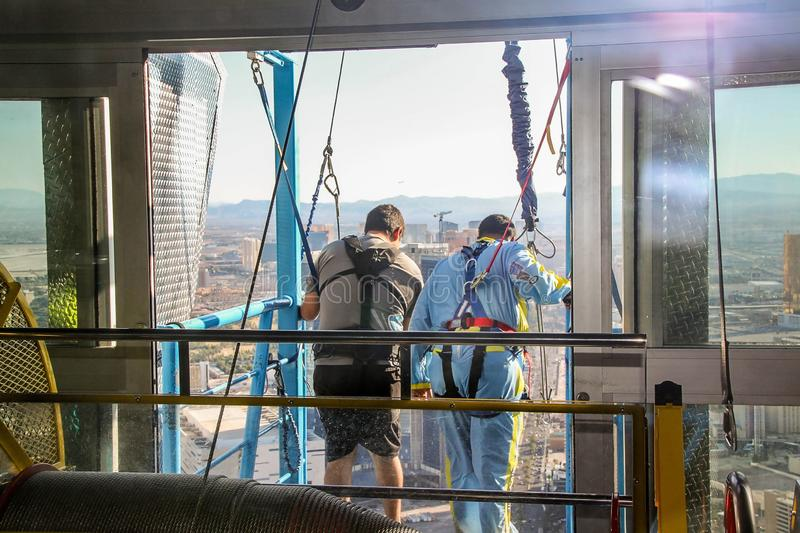 People preparing to a sky jump from Stratosphere Tower i Las Vegas Strip. Beauutiful backgrounds. stock photo