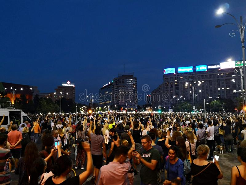 People protest against corruption and abuse in Bucharest. Crowds of Romanian people have gathered in front of Government building to protest against abuse in stock photo