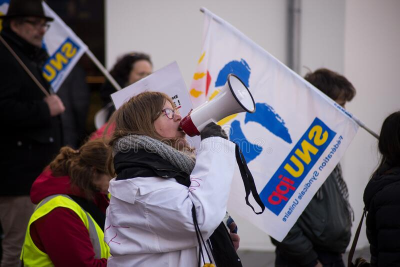 People protesting with megaphone in the street agains the pension reforms from the government stock photos