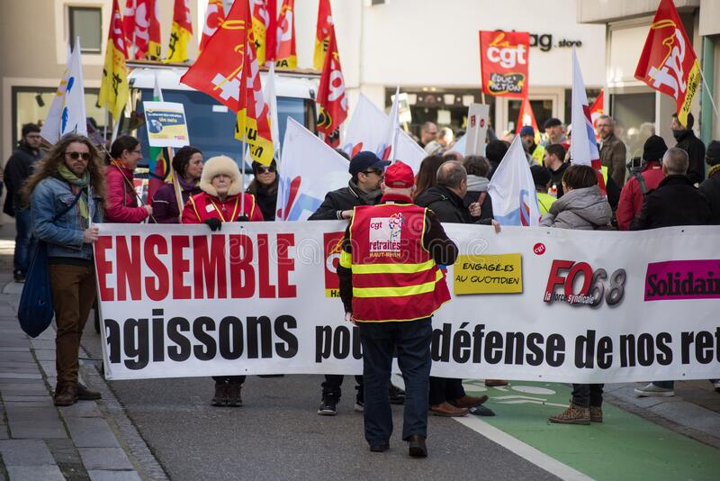 People protesting in the street with flags against the pension reform from the government stock photography