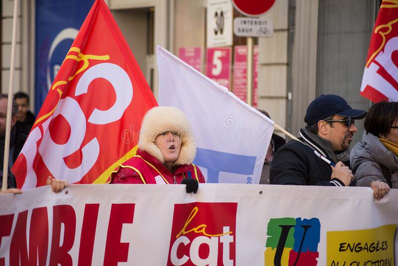 People protesting in the street with flags against the pension reform from the government stock photo