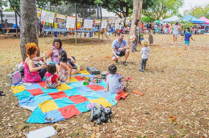 People on public square enjoying the sunday on the Praça Bolivia event. Campo Grande, Brazil - July 08, 2018: People on public square enjoying the sunday on royalty free stock image