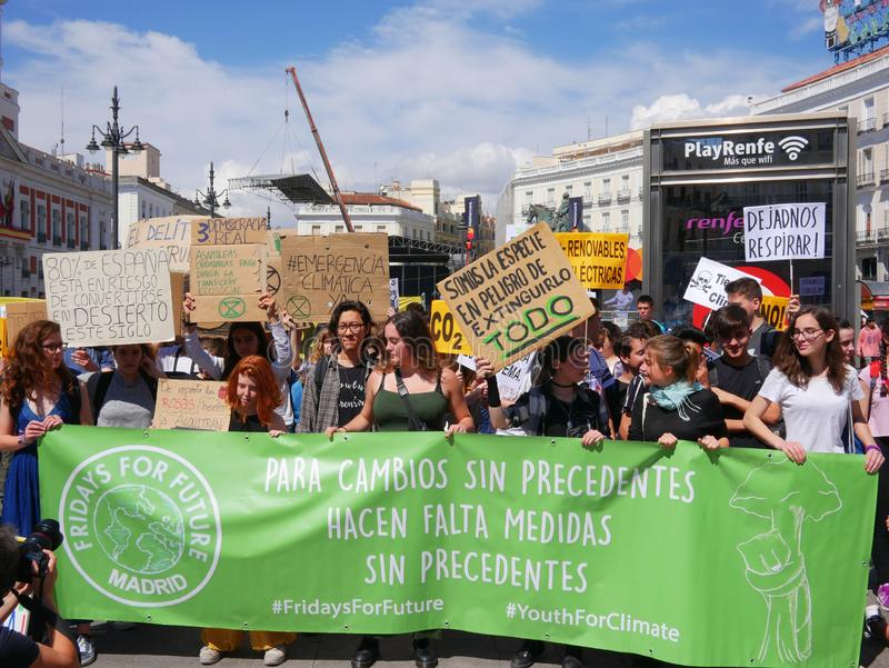People in Puerta del Sol manifest in favor of the environment and the earth. Madrid, Spain - May 2019: People in Puerta del Sol stock image