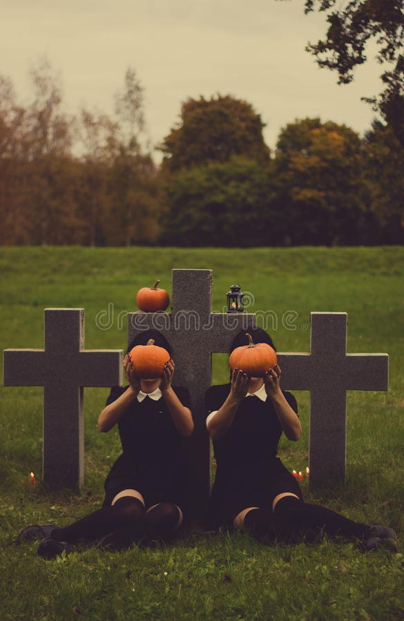 People with pumpkins on graveyard royalty free stock image
