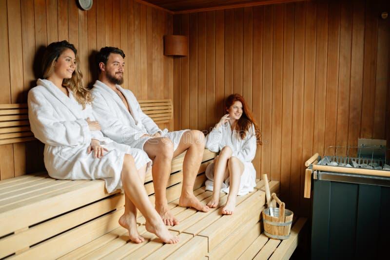 People relaxing in sauna stock photos