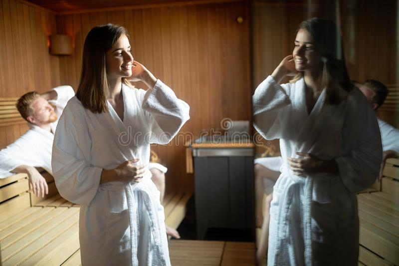 People pursuing healthy lifestyles relaxing in sauna stock image