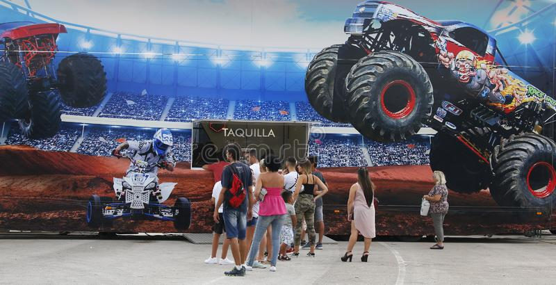 People on queue to get their ticket to monster trucks event in mallorca. People on queue to get their ticket before a monster trucks motorshow event in mallorca stock photo