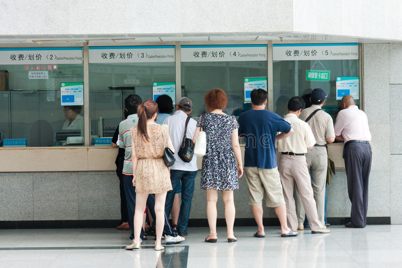 People in the queue at the windows of the hospital stock photo