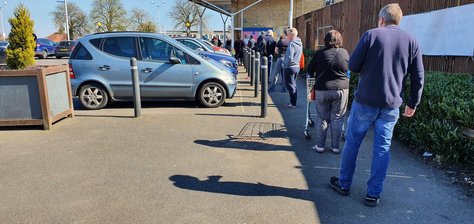 People queuing during coronavirus outbreak royalty free stock photo