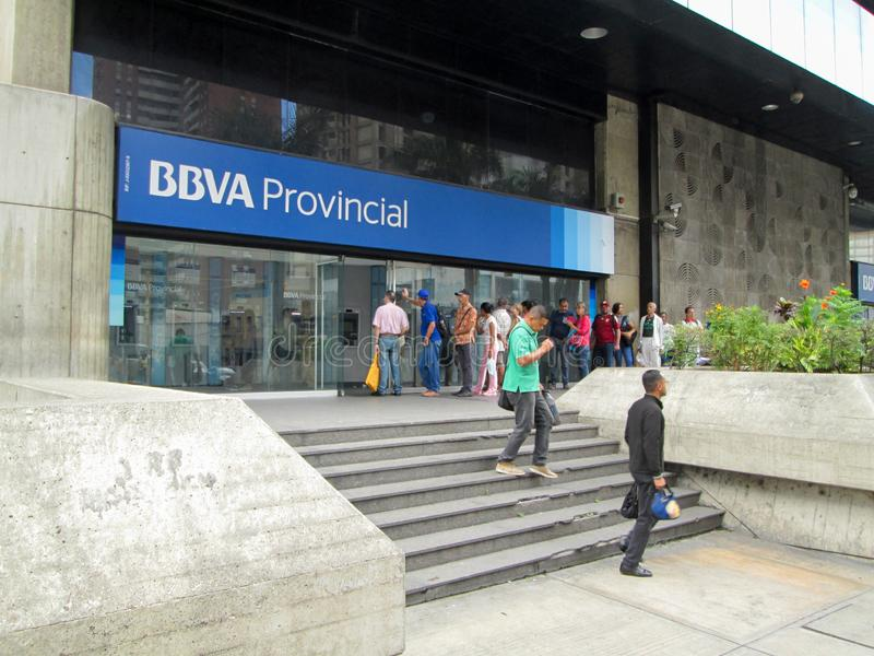 People queuing to withdraw money from ATMs of the BBVA Provincial Bank, at its headquarters.  royalty free stock photo
