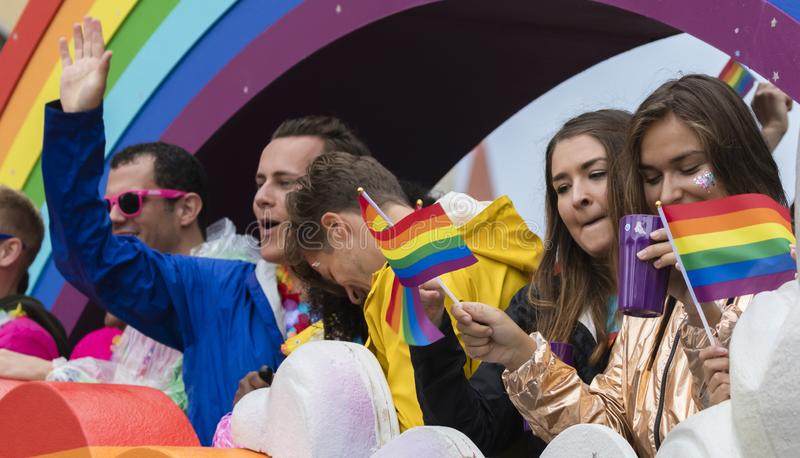 People on a rainbow float attending the Gay Pride parade also known as Christopher Street Day CSD in Munich, Germany. 2019: People on a rainbow float attending stock photo