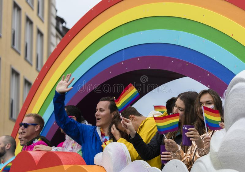 People on a rainbow float attending the Gay Pride parade also known as Christopher Street Day CSD in Munich, Germany. 2019: People on a rainbow float attending royalty free stock image