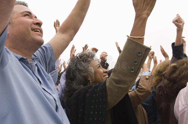 People With Raised Hands In Rally