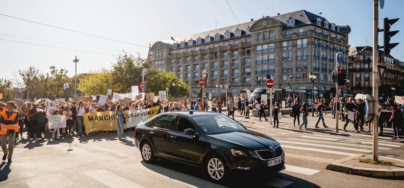 People rally for action on climate change police car surveillance royalty free stock photo