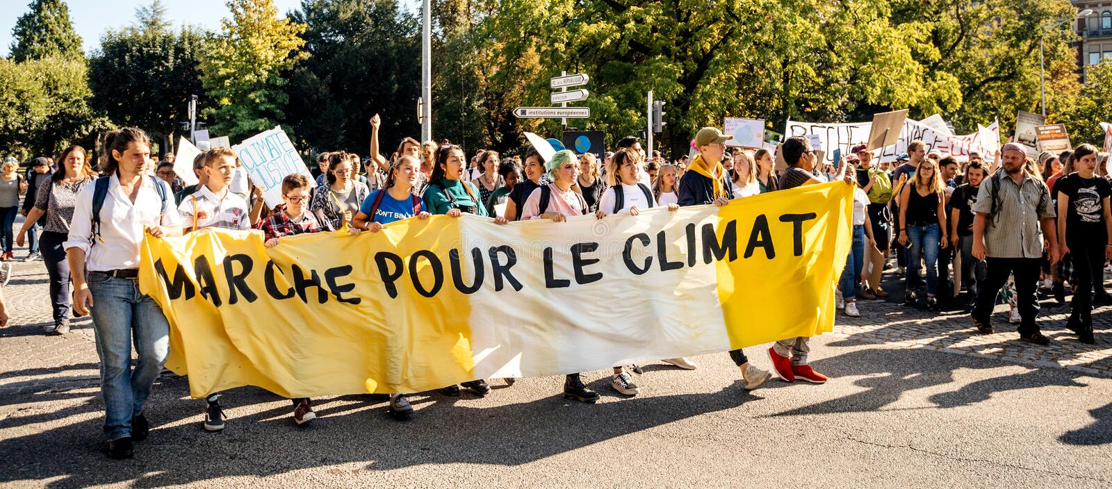 People rally for action on climate change yellow placard stock photos