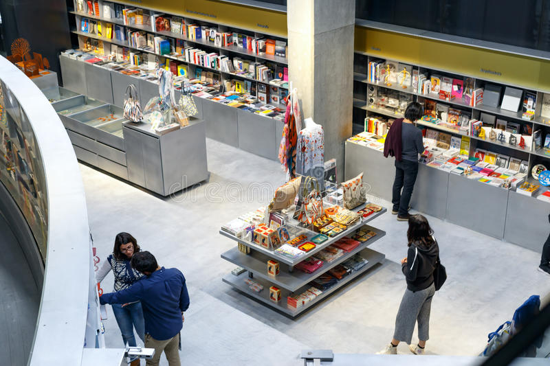 People reading and shopping at new cultural center of the Isla de la Cartuja. Seville, Spain. royalty free stock photo
