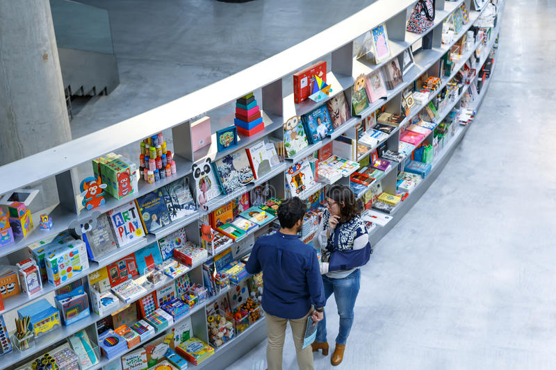 People reading and shopping at new cultural center of the Isla de la Cartuja. Seville, Spain. royalty free stock images