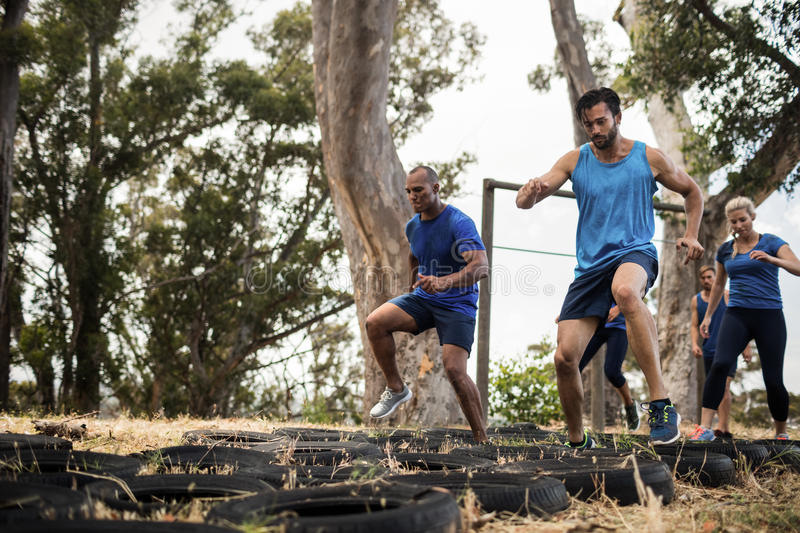 People receiving tire obstacle course training royalty free stock image