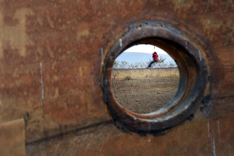 People recreation with simple zip line in a countryside area. Creative composition royalty free stock photo