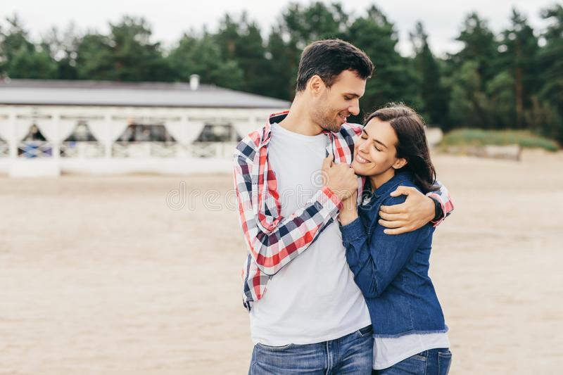 Couple in love embrace each other stock photo