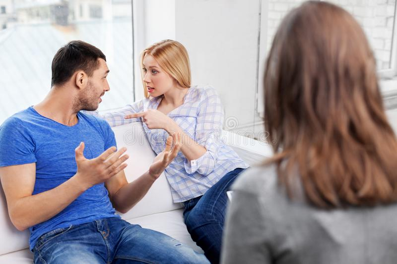 Couple with problem at family psychologist office. People, relationship difficulties and family therapy concept - couple with problem at psychologist office stock image