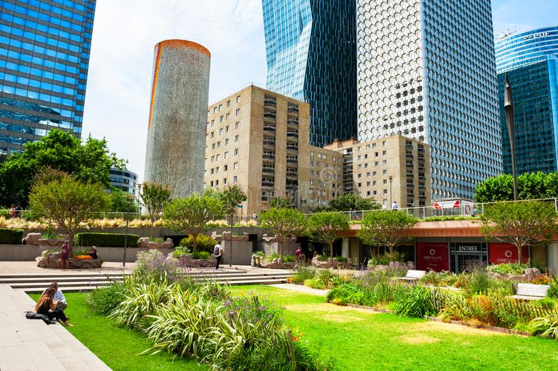 People relax in the park in La Defense business district in Paris, France royalty free stock photos