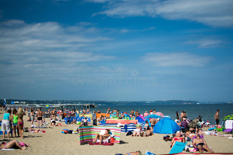 People relaxing on the beach stock photo