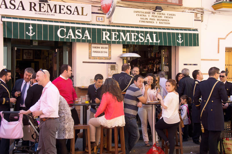 People relaxing and drinking on a terrace after the procession o stock image