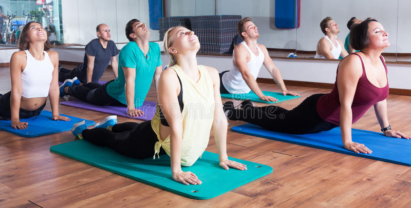 People relaxing and enjoying yoga royalty free stock photography