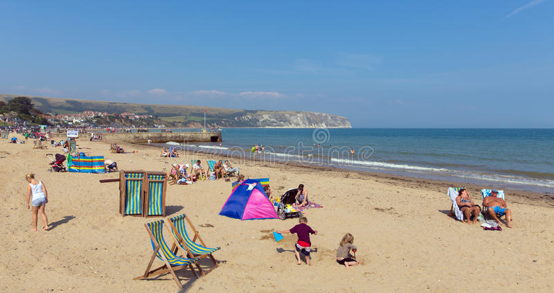 Download People Relaxing In Summer Sunshine Swanage Beach Dorset England UK With Waves On The Shore