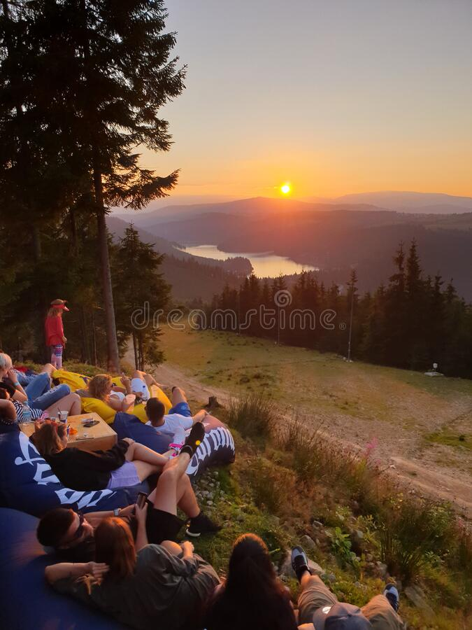 Free People Relaxing Watching Sunset In The Mountains Royalty Free Stock Image - 196453806