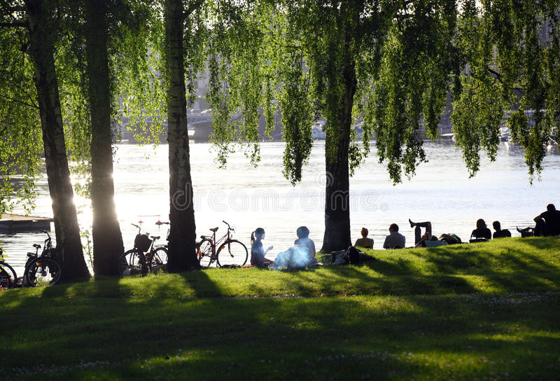 People relaxing by the water in Stockholm royalty free stock image