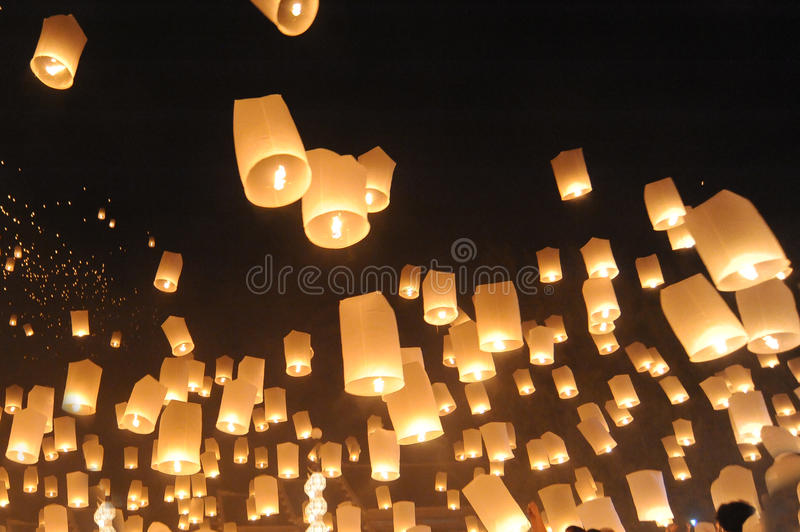 People release Khom Loi, the sky lanterns during Yi Peng or Loi Krathong festival. CHIANG MAI, THAILAND - November 24, 2012: People release Khom Loi, the sky stock photography