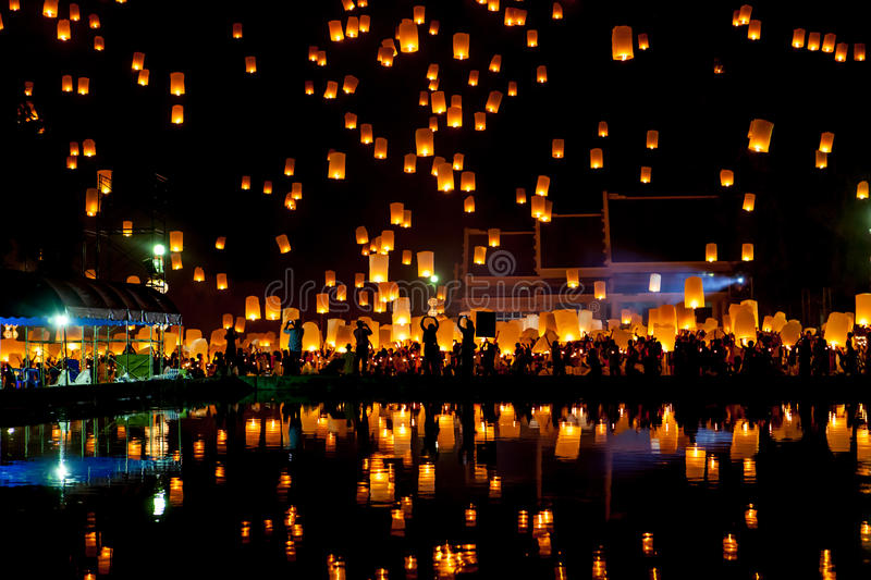 People release sky lanterns to pay homage to the. stock photography