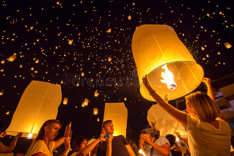 People release sky lanterns to worship Buddha's relics. CHIANGMAI, THAILAND - NOV 16: People release sky lanterns to worship Buddha's relics during Yi Peng stock images