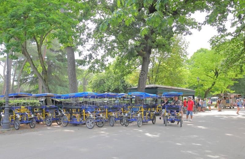 Bicycle rental shop Borghese garden park Rome Italy. People rent bicycle at Borghese park Rome Italy stock photo