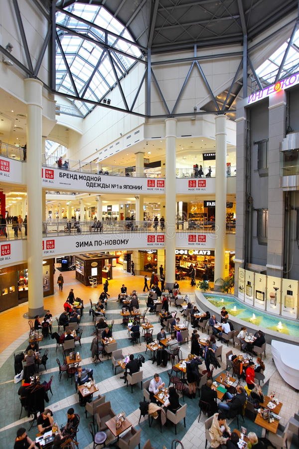 People rest in mall. MOSCOW - OCTOBER 28, 2011: People rest in ATRIUM mall cafe on October 28, 2011 in Moscow. ATRIUM is one of biggest Moscow malls. There are royalty free stock photo
