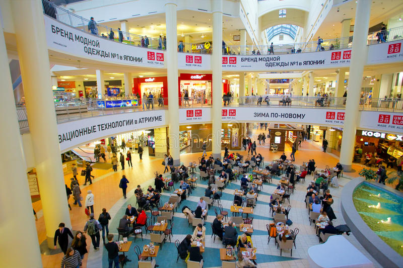 People rest in mall. MOSCOW - OCTOBER 28, 2011: People rest in ATRIUM mall cafe on October 28, 2011 in Moscow. ATRIUM is one of biggest Moscow malls. There are royalty free stock image