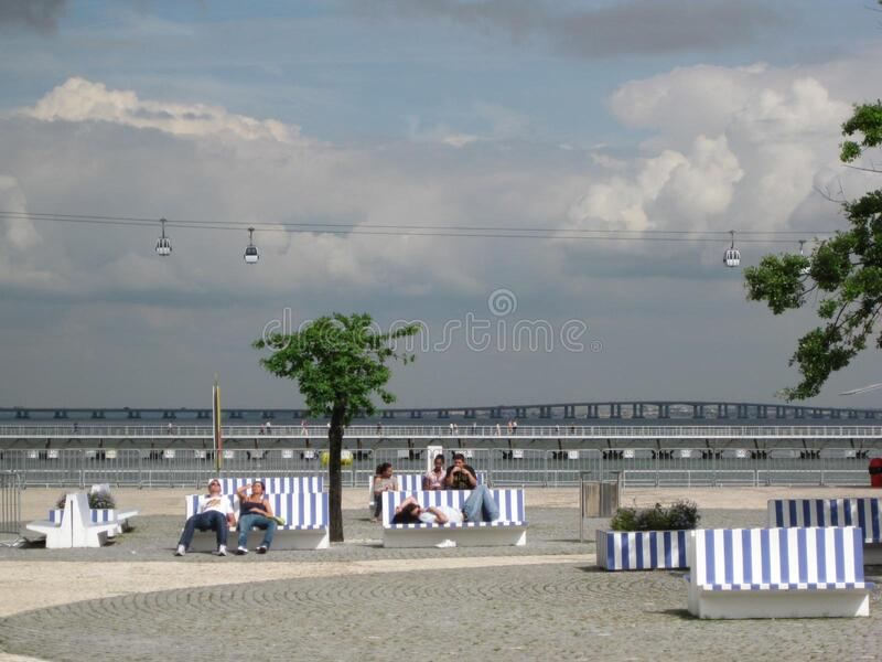 People resting on benches royalty free stock photography