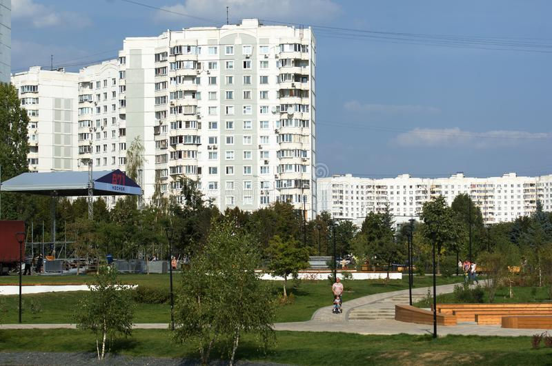 People resting in Butovo park, estate buildings on background, Moscow, Russia royalty free stock image