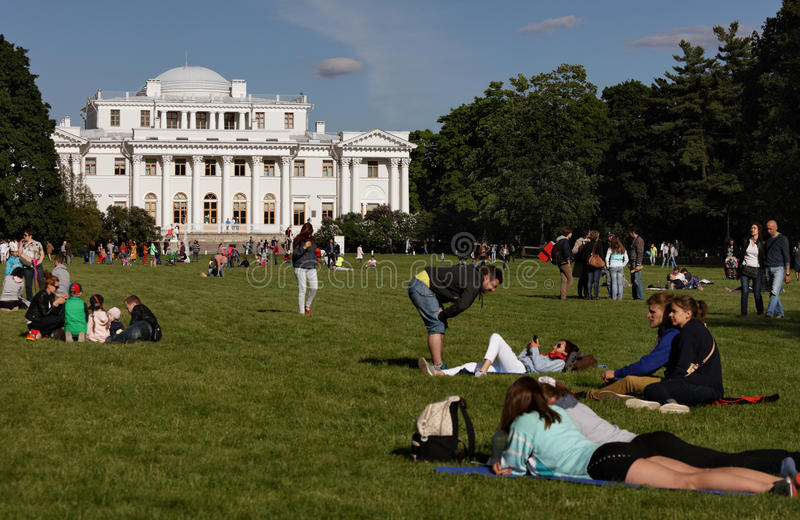 People resting on the Buttery Meadow royalty free stock images