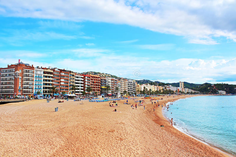 People are resting in european village Lloret de Mar stock photography