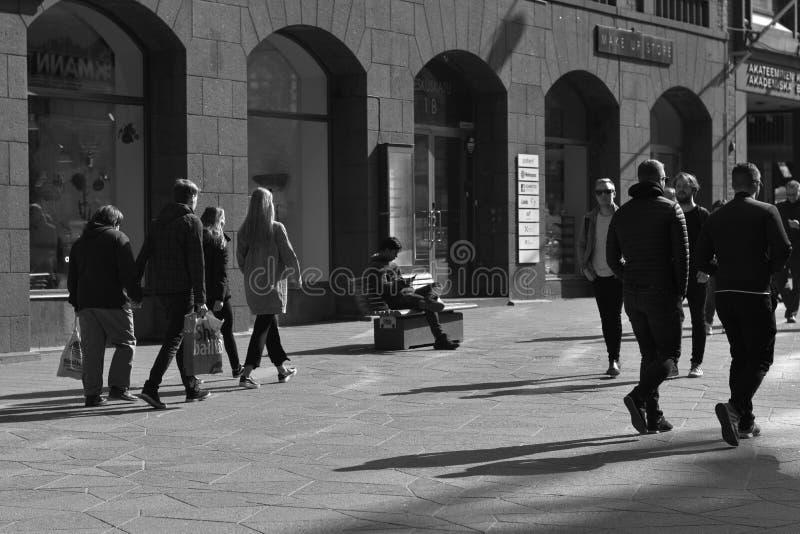 Helsinki/Finland - April 07 2019: People walking on street of a european city stock photography